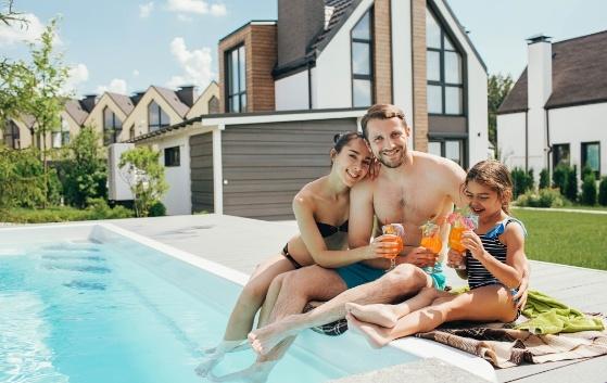 Family Enjoying Their Pool